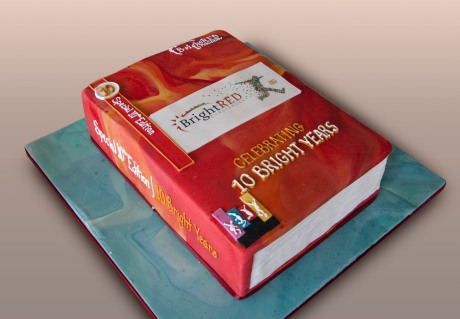 Bright Red birthday cake in the shape of a book