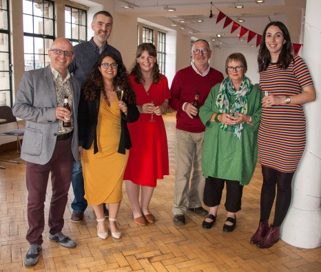 Bright Red Publishing team holding drinks