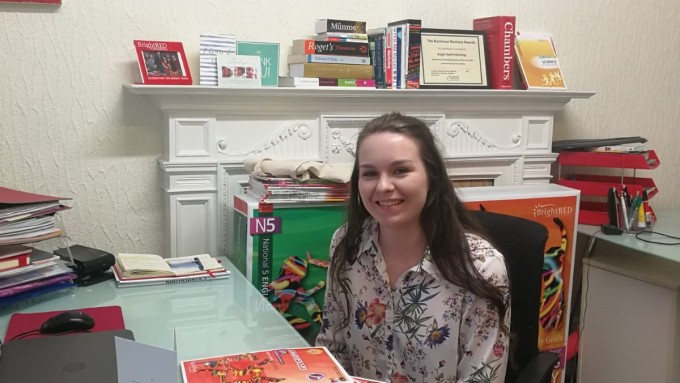Publishing student sitting at a desk in Bright Red office